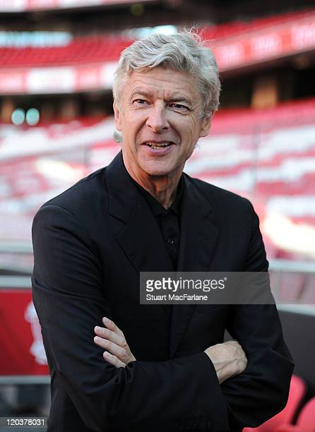 Arsenal manager Arsene Wenger looks at the pitch prior to press conference ahead of the Eusebio Cup match against Benfica at Estadio da Luz on August...