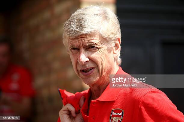 Arsenal manager Arsene Wenger looks on ahead of the pre season friendly match between Borehamwood and Arsenal at Meadow Park on July 19 2014 in...