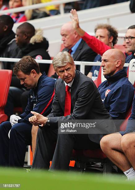 Arsenal manager Arsene Wenger looks on before the Barclays Premier League match between Arsenal and Stoke City at Emirates Stadium on September 22...