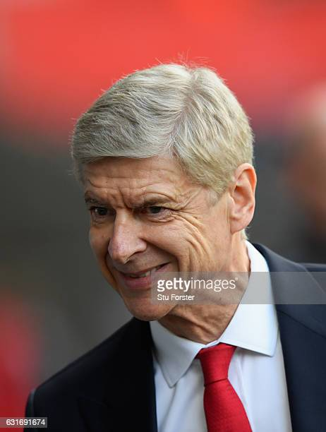 Arsenal manager Arsene Wenger looks on before the Premier League match between Swansea City and Arsenal at Liberty Stadium on January 14 2017 in...