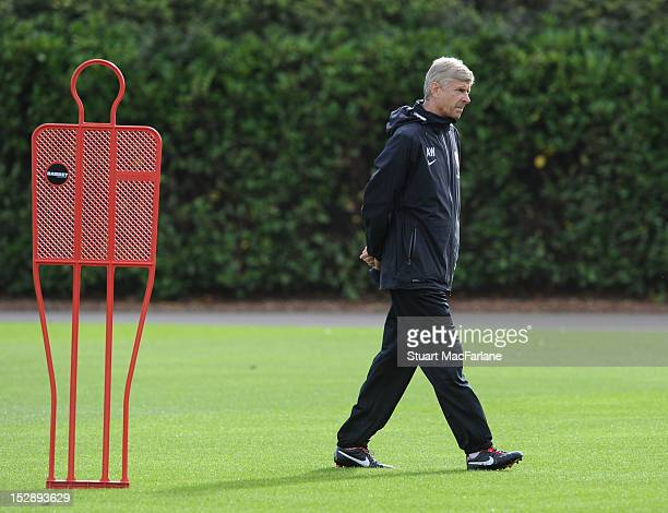 Arsenal manager Arsene Wenger looks on during a training session at London Colney on September 28, 2012 in St Albans, England.