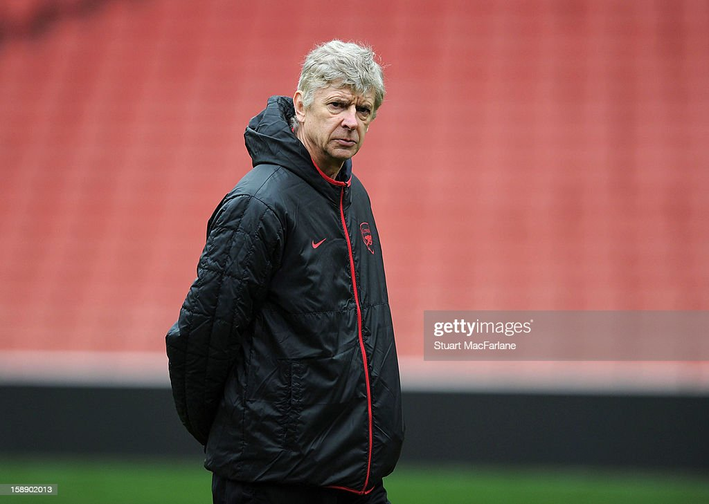 Arsenal manager Arsene Wenger looks on during a training session at Emirates Stadium on January 03, 2013 in London, England.