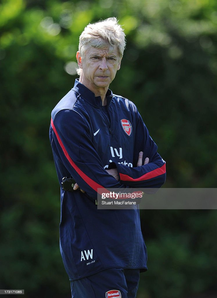 Arsenal manager Arsene Wenger looks on during a training session at London Colney on July 09, 2013 in St Albans, England.
