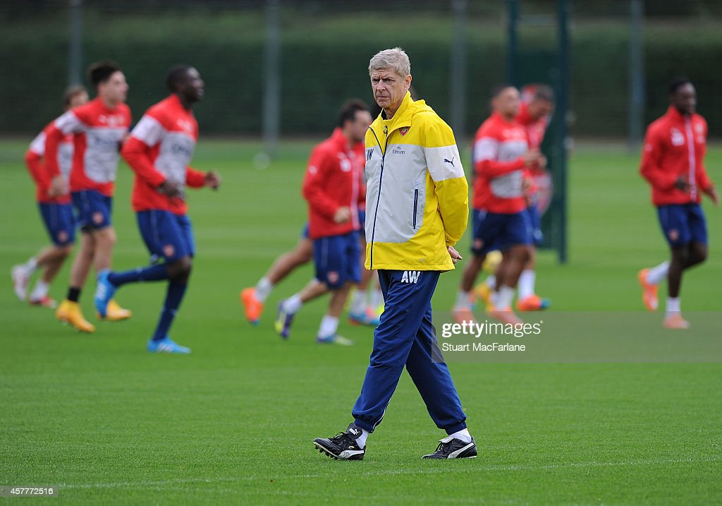 Arsenal manager Arsene Wenger looks on during a training session at London Colney on October 24, 2014 in St Albans, England.