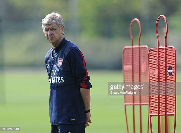 Arsenal manager Arsene Wenger looks on during a training session at London Colney on May 16 2014 in St Albans England