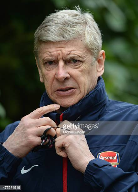 Arsenal manager Arsene Wenger looks on during the Arsenal training session at London Colney on March 10, 2014 in St Albans, England.