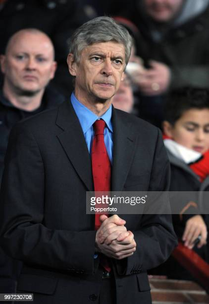 Arsenal manager Arsene Wenger looks on during the Barclays Premier League match between Manchester United and Arsenal at Old Trafford on December 13...