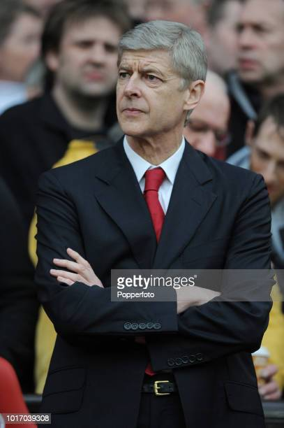 Arsenal manager Arsene Wenger looks on during the FA Cup sponsored by Eon 6th round match between Manchester United and Arsenal at Old Trafford on...