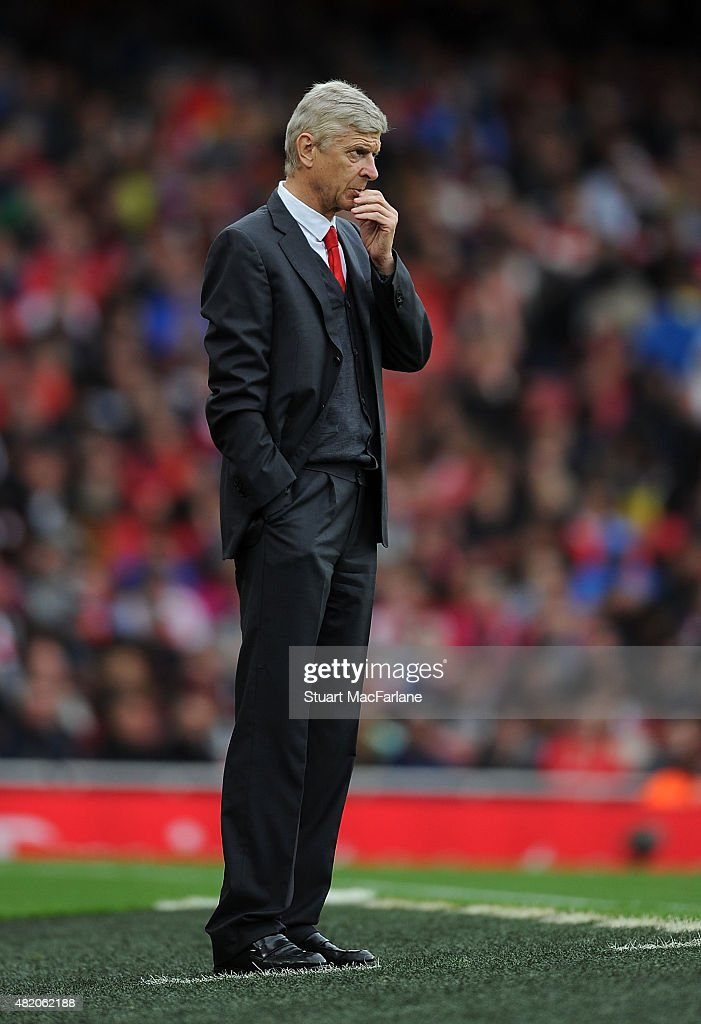 Arsenal manager Arsene Wenger looks on during the match between Arsenal and VfL Wolfsburg at Emirates Stadium on July 26, 2015 in London, England.
