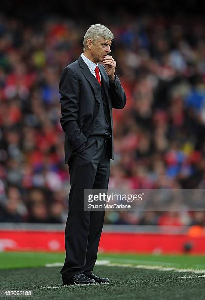 Arsenal manager Arsene Wenger looks on during the match between Arsenal and VfL Wolfsburg at Emirates Stadium on July 26 2015 in London England