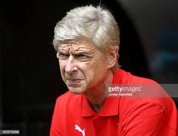 Arsenal manager Arsene Wenger looks on during the pre season friendly match between Borehamwood and Arsenal at Meadow Park on July 19 2014 in...