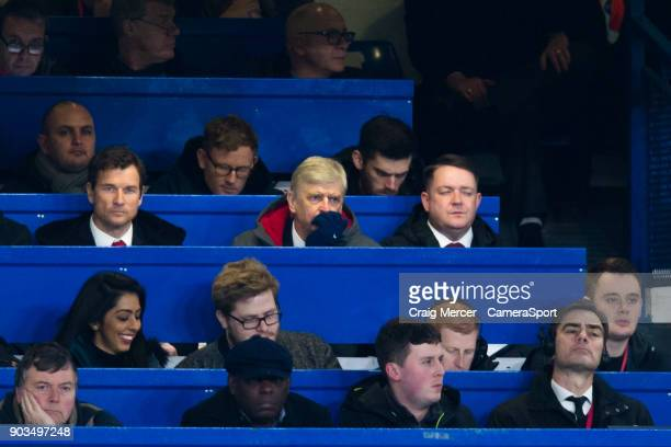 Arsenal manager Arsene Wenger looks on from the press box during the Carabao Cup SemiFinal First Leg match between Chelsea and Arsenal at Stamford...