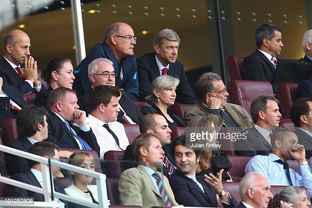 Arsenal manager Arsene Wenger looks on from the stands as he serves a one match touchline ban during the UEFA Champions League playoff first leg...