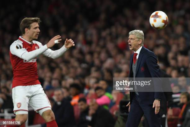 Arsenal manager Arsene Wenger makes a point to the referee during the UEFA Europa League Semi Final leg one match between Arsenal FC and Atletico...