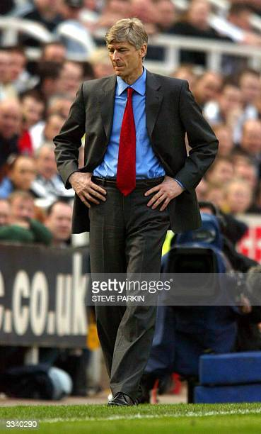 Arsenal manager Arsene Wenger of France is pictured during his team's match against Newcastle 11 April 2004 in Newcastle AFP PHOTO/STEVE PARKIN