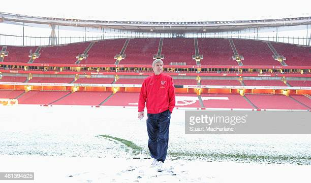 Arsenal manager Arsene Wenger on the pitch at Emirates Stadium on January 6 2010 in London England