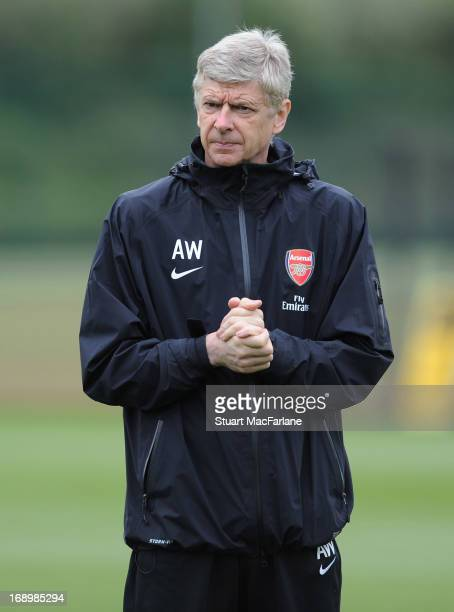 Arsenal manager Arsene Wenger oversees a training session at London Colney on May 18 2013 in St Albans England