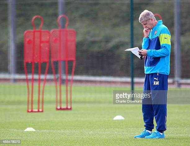 Arsenal manager Arsene Wenger ponders during a Arsenal Training Session ahead of their Champions League fixture against Borussia Dortmund on...