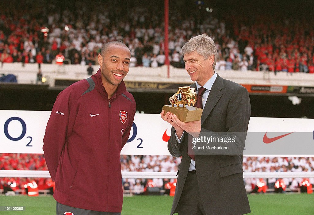 Arsenal manager Arsene Wenger presents striker Thierry Henry with the Golden boot after the match between Arsenal and Wigan Athletic, the last match at Highbury, at Arsenal Stadium, Highbury on May 7, 2006 in London, England.