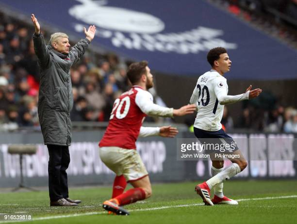 Arsenal manager Arsene Wenger reacts alongside Shkodran Mustafi and Tottenham Hotspur's Dele Alli during the Premier League match at Wembley Stadium...