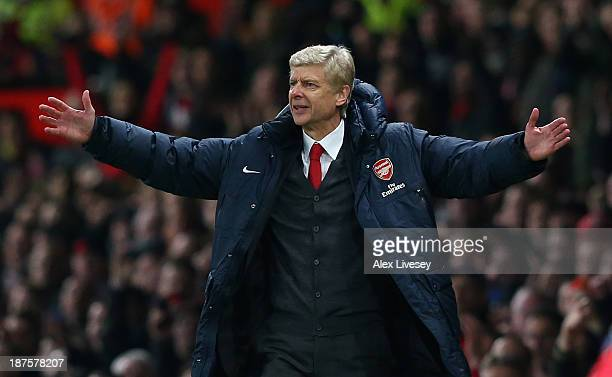 Arsenal Manager Arsene Wenger reacts during the Barclays Premier League match between Manchester United and Arsenal at Old Trafford on November 10...