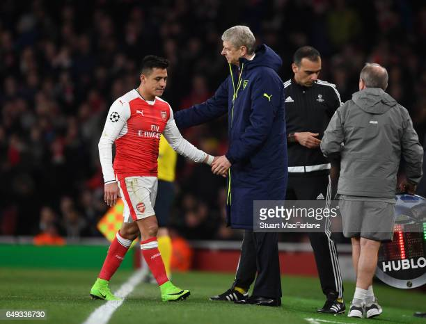 Arsenal manager Arsene Wenger shakes hands with Alexis Sanchez after his substitution during the UEFA Champions League Round of 16 second leg match...