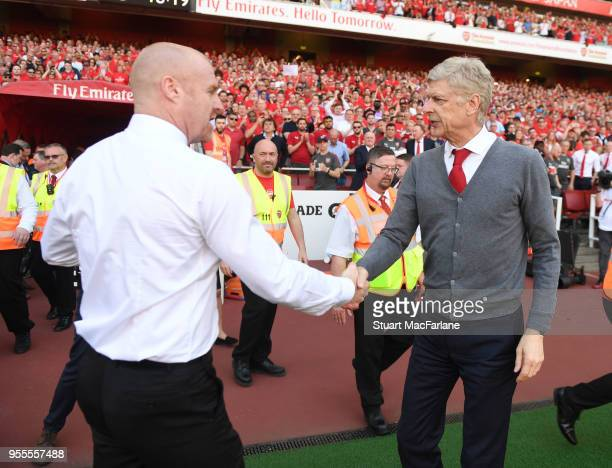 Arsenal manager Arsene Wenger shakes hands with Burnley manager Sean Dyche after the Premier League match between Arsenal and Burnley at Emirates...