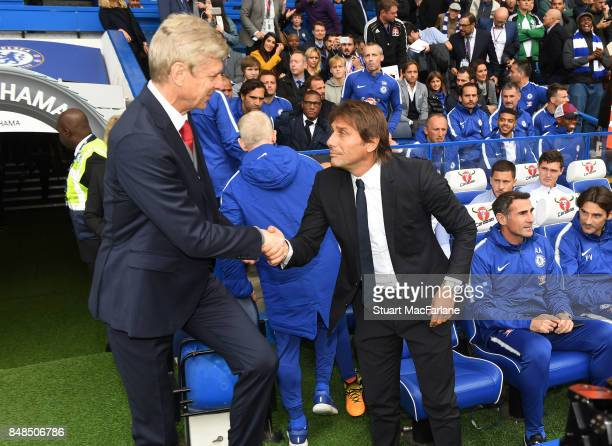 Arsenal manager Arsene Wenger shakes hands with Chelsea manager Antonio Conte before during the Premier League match between Chelsea and Arsenal at...