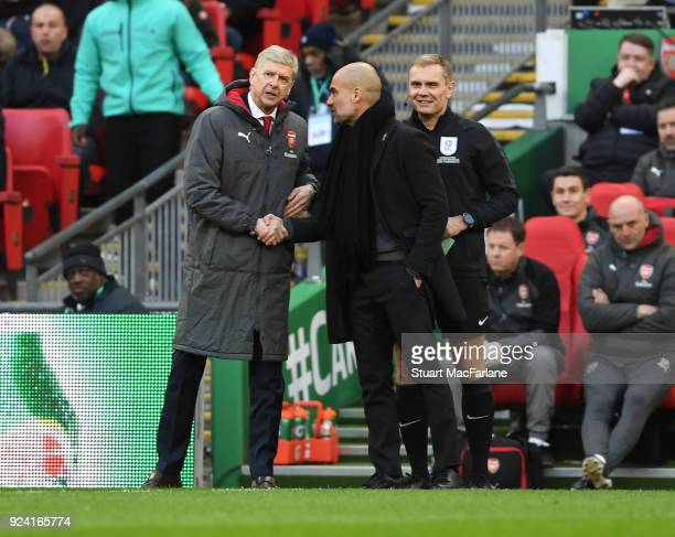 Arsenal manager Arsene Wenger shakes hands with Man City manager Pep Guardiola during the Carabao Cup Final between Arsenal and Manchester City at...