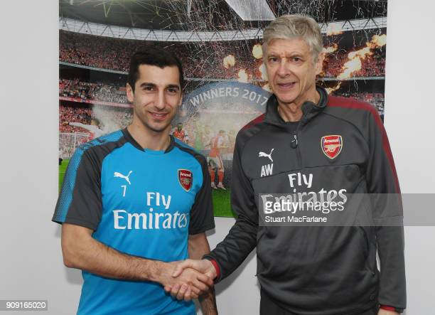 Arsenal manager Arsene Wenger shakes hands with new signing Henrikh Mkhitaryan before a training session at London Colney on January 23 2018 in St...