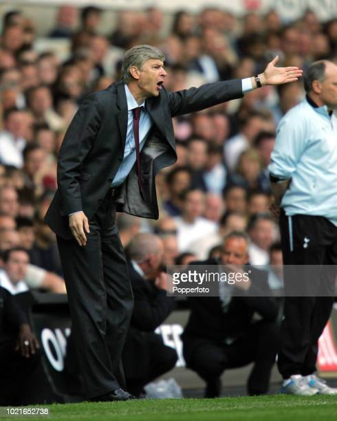 Arsenal manager Arsene Wenger shouts instructions from the touchline during the Barclay's Premiership match between Tottenham Hotspur and Arsenal at...