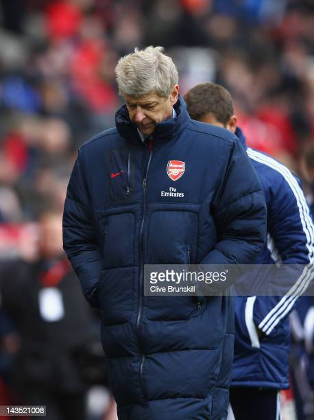 Arsenal manager Arsene Wenger shows his dejection at the final whistle of the Barclays Premier League match between Stoke City and Arsenal at...