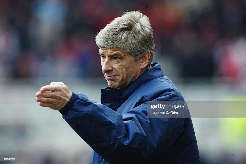 Arsenal manager Arsene Wenger signals to his players during the FA Barclaycard Premiership match between Middlesbrough and Arsenal held on April 19, 2003 at The Riverside Stadium in Middlesbrough, England. Arsenal won the match 2-0.