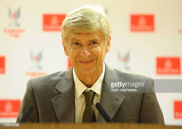 Arsenal manager Arsene Wenger smiles during a press conference for the Emirates Cup at Emirates Stadium on August 02 2013 in London England