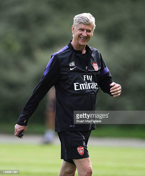 Arsenal manager Arsene Wenger smiles during the evening training session at Arsenal Training Camp on August 8 2012 in Hennef Germany
