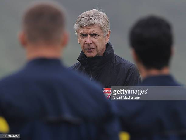 Arsenal manager Arsene Wenger speaks to players during a training session ahead of their UEFA Champions League group stage match against Schalke 04...