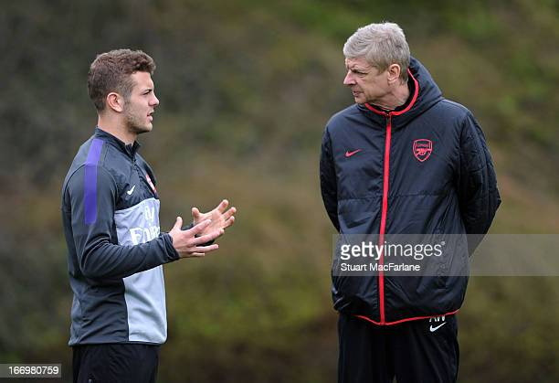 Arsenal manager Arsene Wenger speaks with Jack Wilshere during a training session at London Colney on April 19 2013 in St Albans England