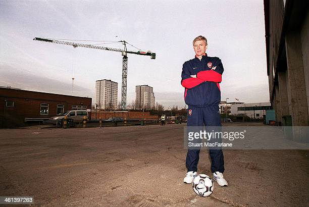 Arsenal manager Arsene Wenger stands on the centre spot of Emirates stadium before construction begins on February 18 2004 in London England