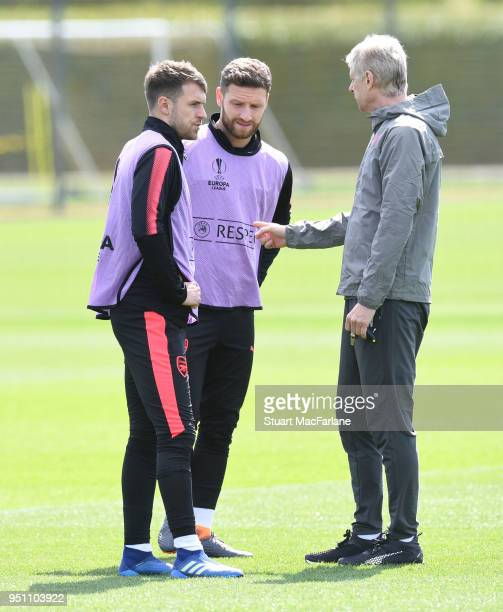 Arsenal manager Arsene Wenger talks to Aaron Ramsey and Shkodran Mustafi during a training session at London Colney on April 25 2018 in St Albans...