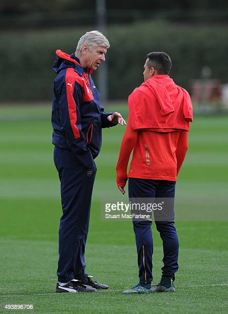 Arsenal manager Arsene Wenger talks to Alexis Sanchez before a training session at London Colney on October 23 2015 in St Albans England