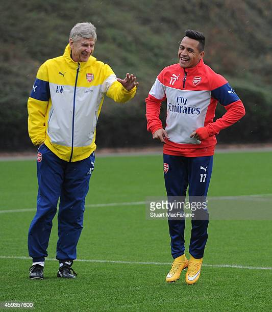 Arsenal manager Arsene Wenger talks to Alexis Sanchez during a training session at London Colney on November 21 2014 in St Albans England Photo by...