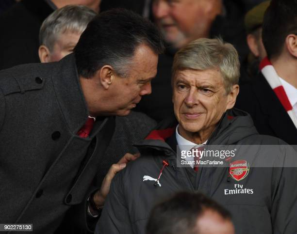 Arsenal manager Arsene Wenger talks to ex player and former Leeds United manager David O'Leary in the directors box before the FA Cup 3rd Round match...