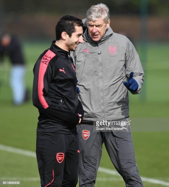 Arsenal manager Arsene Wenger talks to Henrikh Mkhitaryan during a training session at London Colney on March 14 2018 in St Albans England