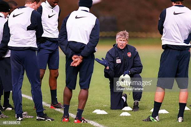 Arsenal manager Arsene Wenger talks to his players during a training session at London Colney on March 15 2004 in St Albans England