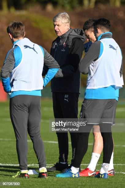 Arsenal manager Arsene Wenger talks to his players during a training session at London Colney on January 19 2018 in St Albans England