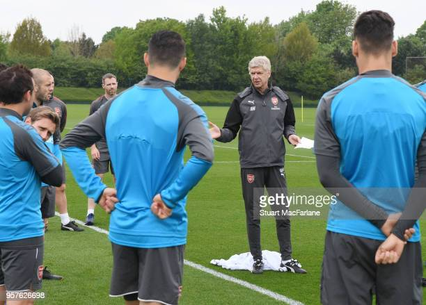 Arsenal manager Arsene Wenger talks to his players during a training session at London Colney on May 12 2018 in St Albans England