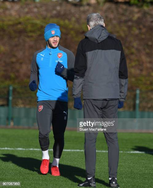 Arsenal manager Arsene Wenger talks to Jack Wilshere during a training session at London Colney on January 19 2018 in St Albans England