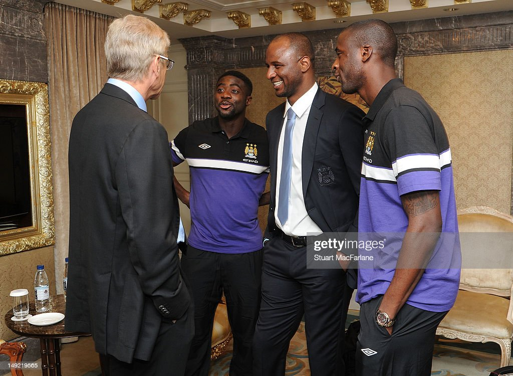 Arsenal manager Arsene Wenger talks to Kolo Toure, Patrick Vieira and Yaya Toure of Manchester City before a charity dinner in Beijing ahead of their pre-season friendly match during Arsenal's pre-season Asian Tour in China on July 25, 2012 in Beijing, China.
