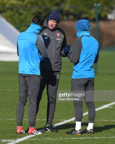 Arsenal manager Arsene Wenger talks to Mesut Ozil and Jack Wilshere during a training session at London Colney on February 24 2018 in St Albans...