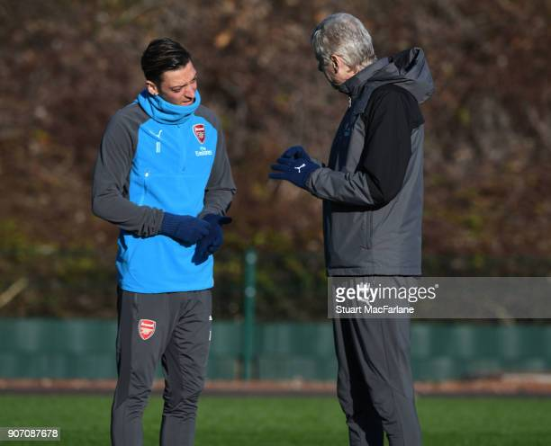 Arsenal manager Arsene Wenger talks to Mesut Ozil before a training session at London Colney on January 19 2018 in St Albans England